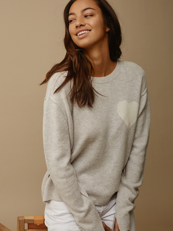 "<span class=""js-statics"" title=""Missing static search site_product_thumbnail"">site_product_thumbnail</span> Women's Heart Sweater"