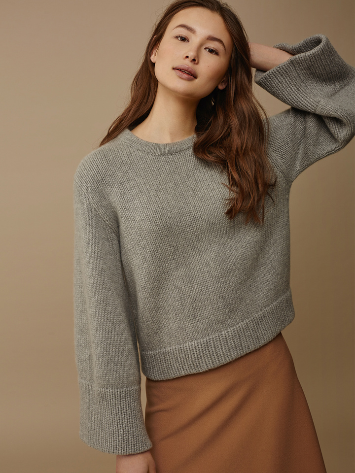 "<span class=""js-statics"" title=""Missing static search site_product_thumbnail"">site_product_thumbnail</span> Women's Jumbo Sleeve Sweater"