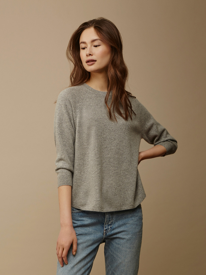 "<span class=""js-statics"" title=""Missing static search site_product_thumbnail"">site_product_thumbnail</span> Women's Rounded Sweater"