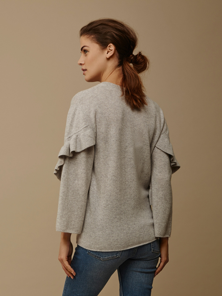 "<span class=""js-statics"" title=""Missing static search site_product_thumbnail"">site_product_thumbnail</span> Women's Ruffle Trim Sweater"