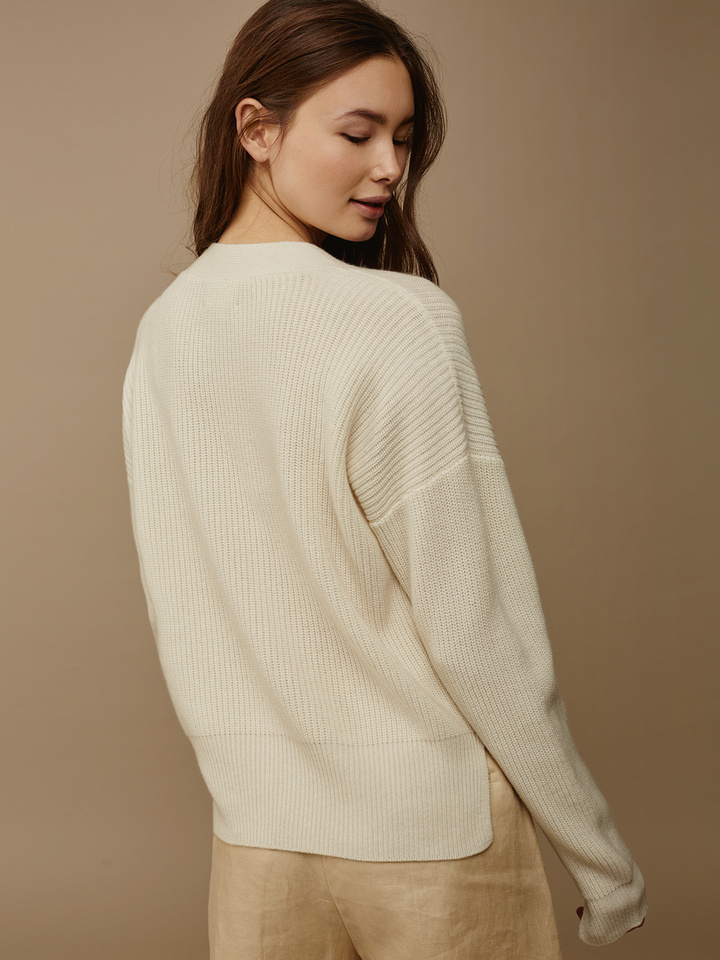"<span class=""js-statics"" title=""Missing static search site_product_thumbnail"">site_product_thumbnail</span> Lace Up Sweater"